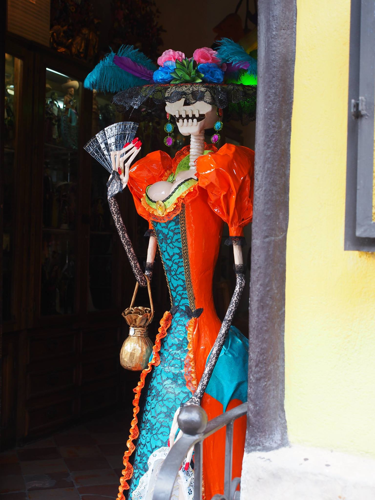 catrina in doorway tlaquepaque close up