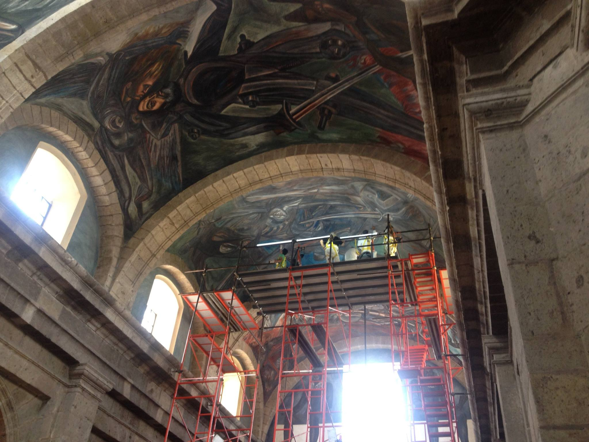 orozco mural with scaffold
