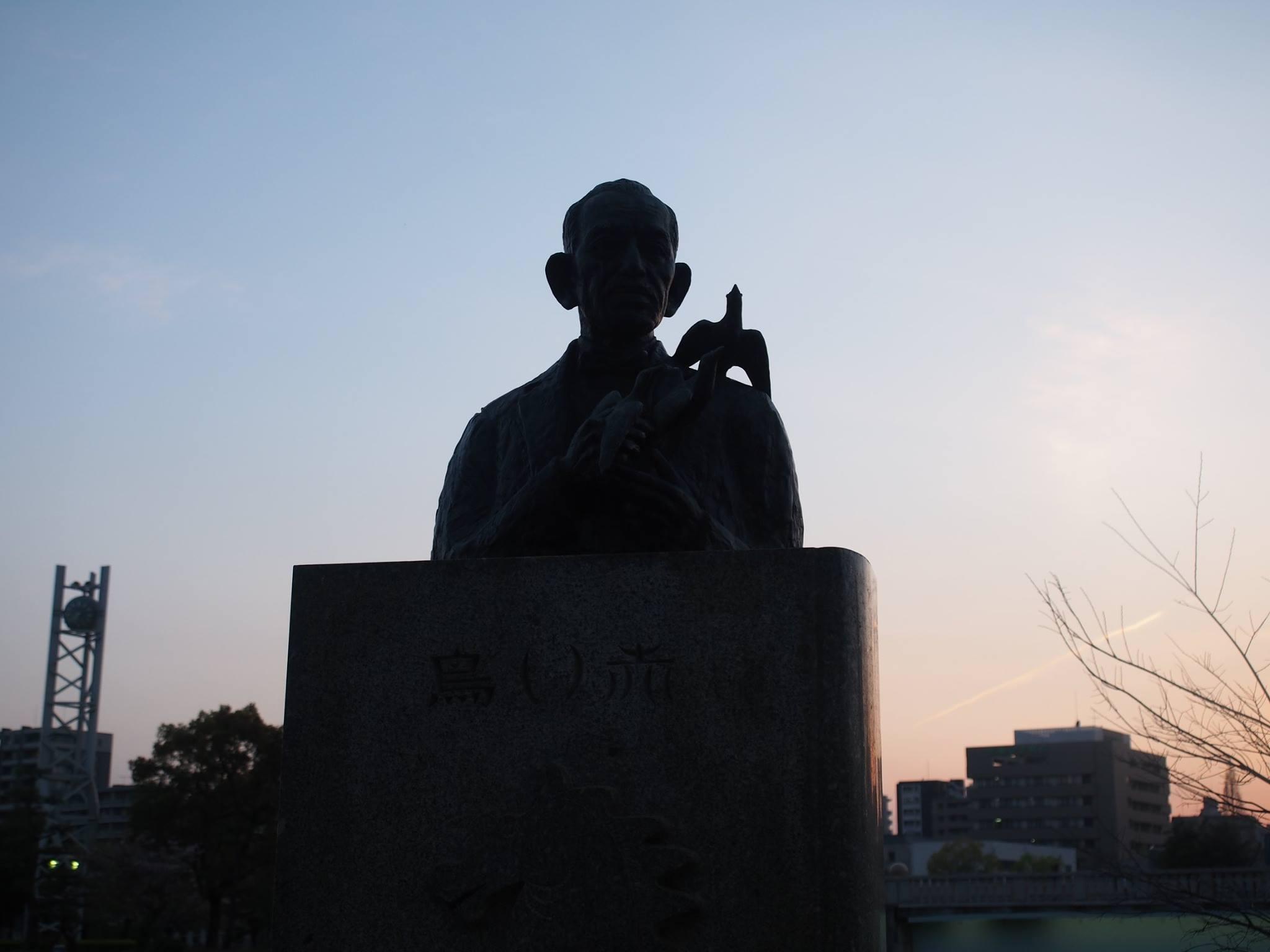 man & dove statue hiroshima