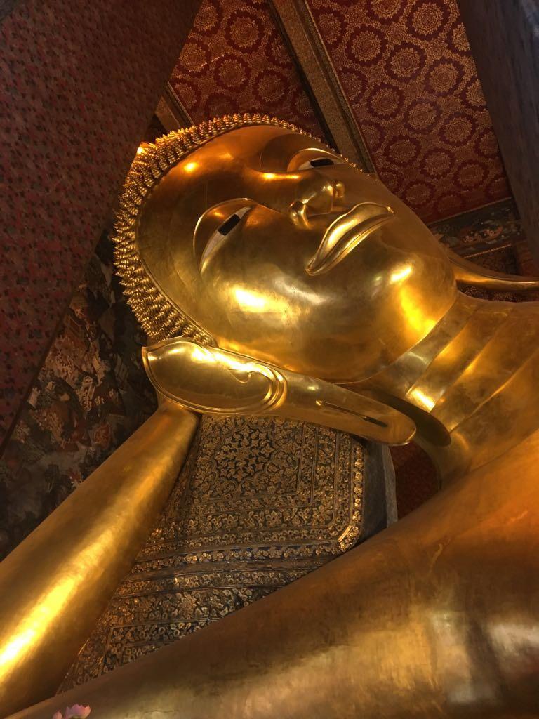 gold reclining budha bangkok thailand